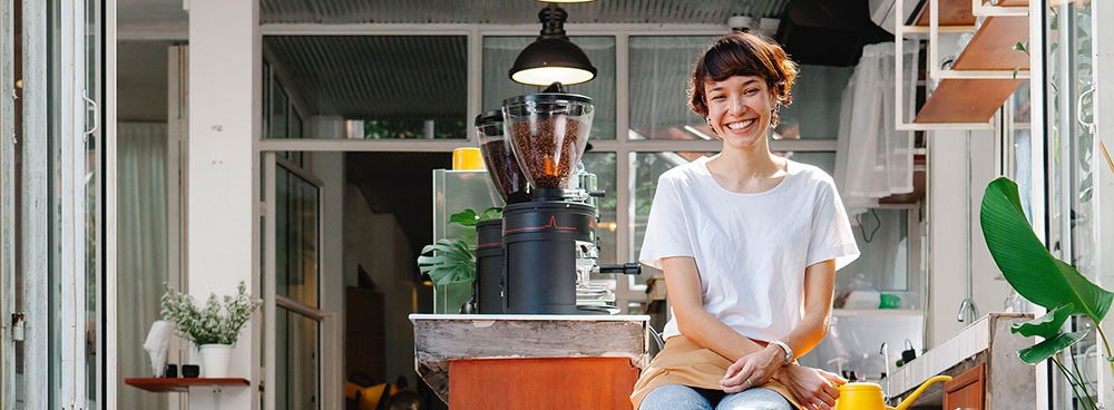 Photo of woman with apron in workplace