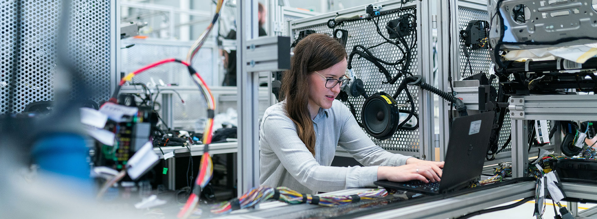 Photo of a female engineer at her work station.
