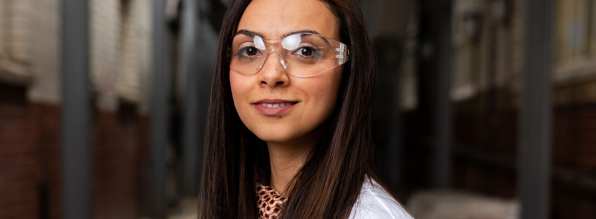 Photo of a woman wearing protective eye gear.