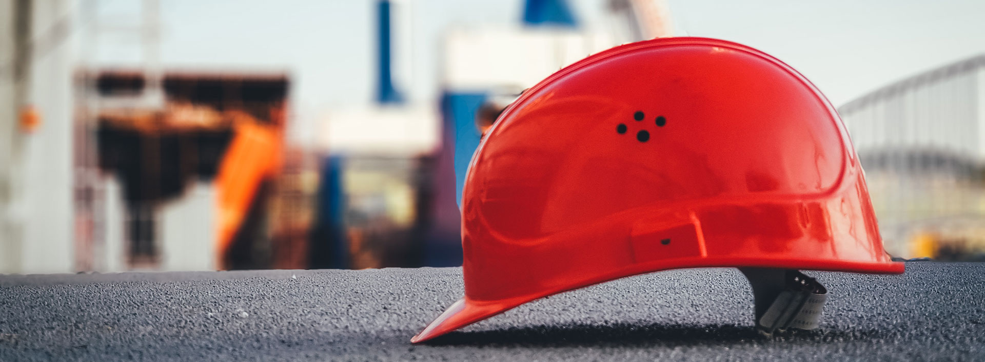 Photo of a hard hat laid down on an industrial surface.